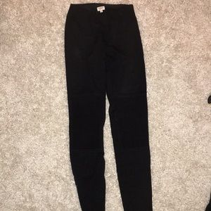 Black high waisted pants with ankle zippers